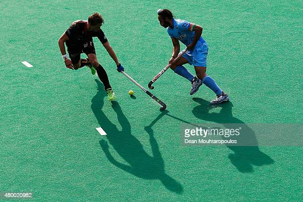 Felix Denayer of Belgium and Sardar Singh of India battle for the ball during the Fintro Hockey World League SemiFinal match between India and...