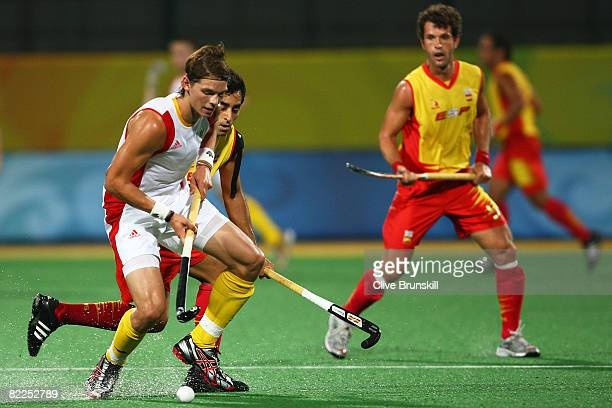 Felix Denayer of Belgium keeps the ball from Eduard Arbos of Spain during their match at the Olympic Green Hockey Field on Day 3 of the Beijing 2008...