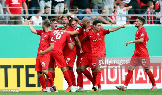Felix Drinkuth of Hallescher FC celebrates after scoring the 1-0 lead with team mates during the DFB Cup first round match between Hallescher FC and...