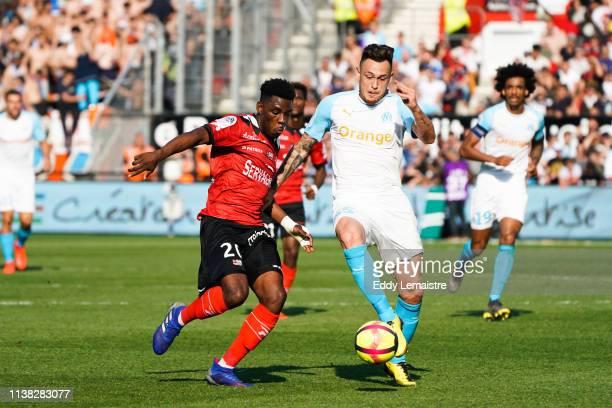 Felix Eboa Eboa of Guingamp and Lucas Ocampos of Marseille during the Ligue 1 match between EA Guingamp and Olympique de Marseille at Stade du...