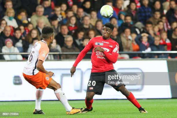 Felix Eboa of Guingamp and Junior Sambia of Montpellier during the French League Cup match between EA Guingamp and Montpellier Herault SC on October...