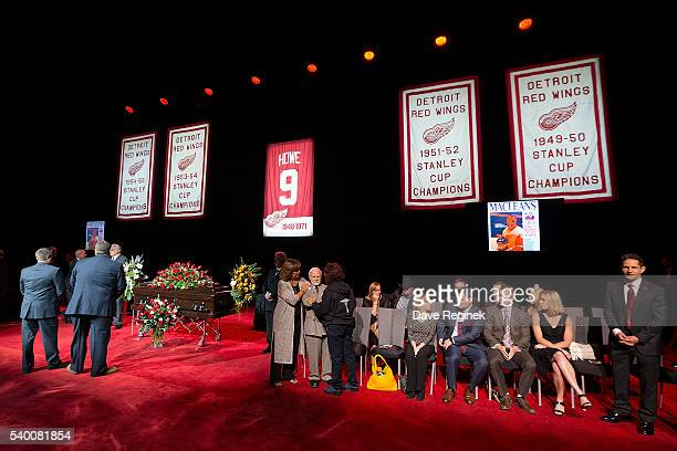 Felix Gatt is comforted by Cathy Howe and family during the Gordie Howe Visitation at Joe Louis Arena on June 14 2016 in Detroit Michigan Howe known...