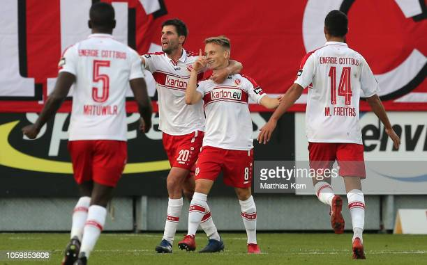 Felix Geisler of Cottbus celebrates with teammates after scoring his team's second goal during the 3 Liga match between FC Energie Cottbus and VfL...