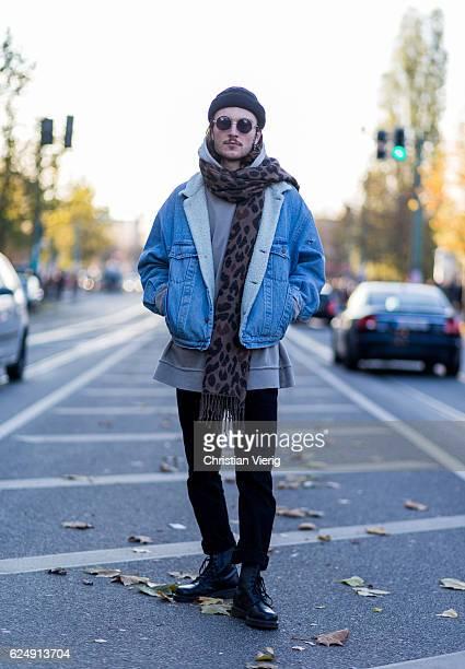 Felix Gerke wearing a denim jacket scarf with leo print wool hat sunglasses grey oversized hoody black pants black heavy boots on November 21 2016 in...