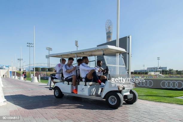 Felix Goetze of Muenchen Niklas Suele of Muenchen Kingsley Coman of Muenchen and Corentin Tolisso of Muenchen drive in a golf cart during the FC...