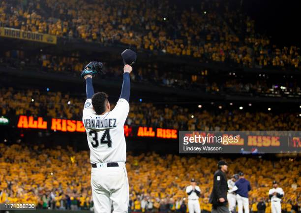 Felix Hernandez of the Seattle Mariners acknowledges cheering fans as he is taken out of the game during his last game with the Seattle Mariners in...