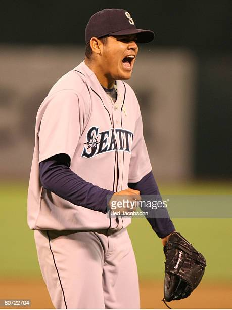 Felix Hernandez of the Seattle Mariners celebrates after striking out Mike Sweeney to the end the 8th inning against the Oakland Athletics during a...