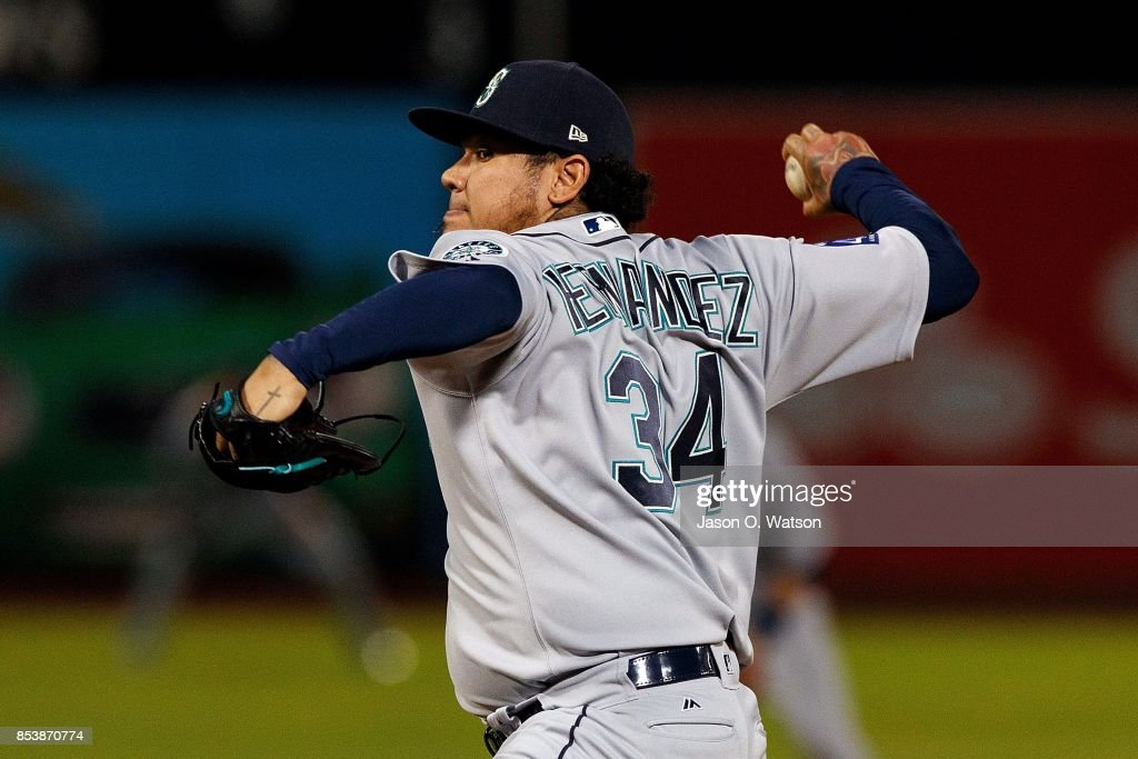 Felix Hernandez #34 of the Seattle Mariners pitches against the Oakland Athletics during the first inning at the Oakland Coliseum on September 25, 2017 in Oakland, California.
