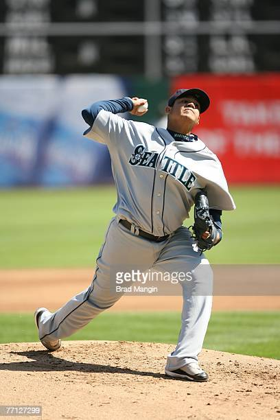 Felix Hernandez of the Seattle Mariners pitches during the game against the Oakland Athletics at the McAfee Coliseum in Oakland California on...