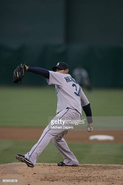 Felix Hernandez of the Seattle Mariners pitches during the game against the Oakland Athletics at the McAfee Coliseum in Oakland California on April...