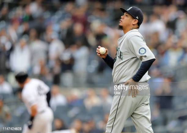 Felix Hernandez of the Seattle Mariners reacts as Luke Voit of the New York Yankees rounds first base after a two run home run in the first inning at...