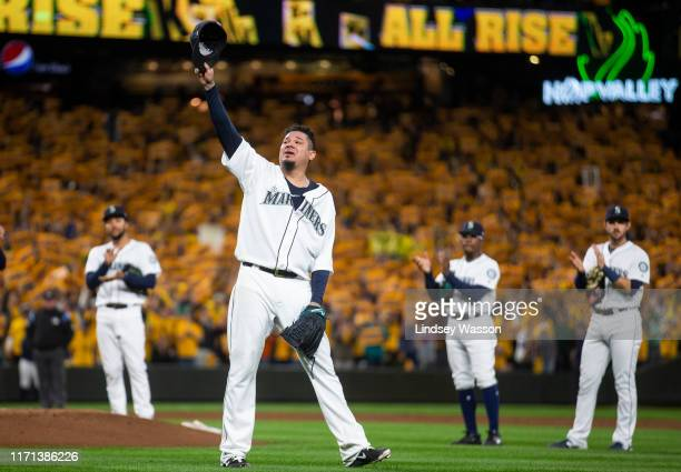 Felix Hernandez of the Seattle Mariners tips his cap to fans as he is taken out of the game during his last game with the Seattle Mariners in the...