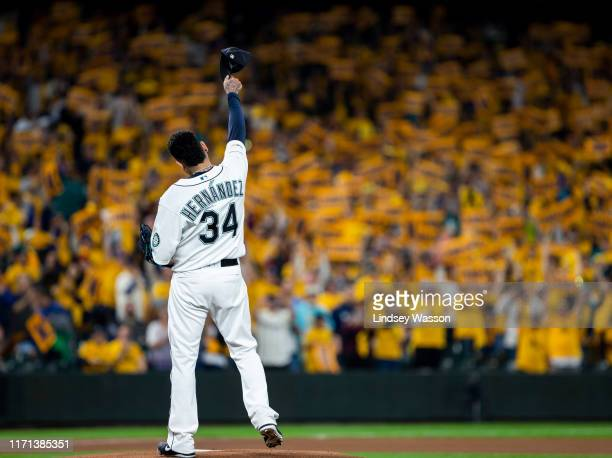 Felix Hernandez of the Seattle Mariners tips his cap to fans in the King's Court section before the game against the Oakland Athletics at T-Mobile...