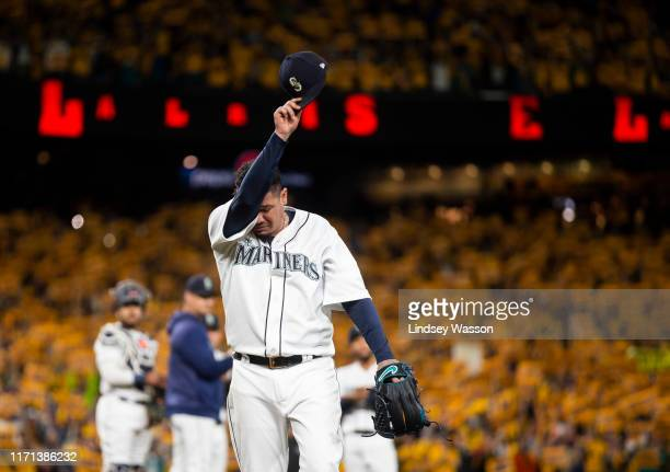 Felix Hernandez of the Seattle Mariners wipes his eyes as he is taken out of the game during his last game with the Seattle Mariners in the sixth...