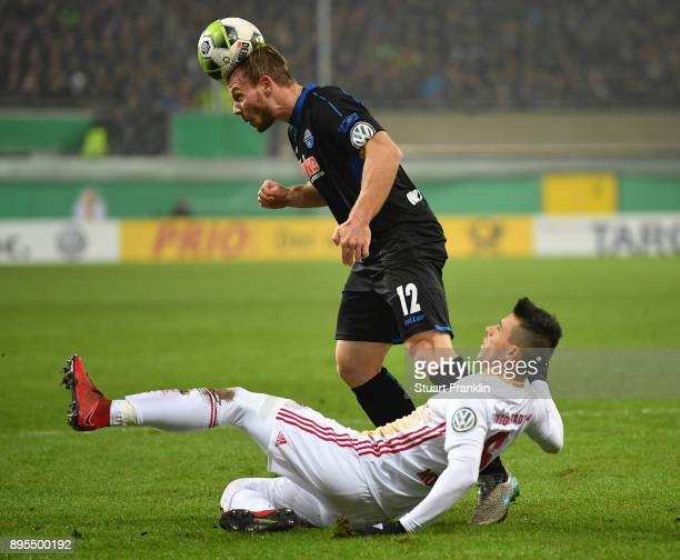 Felix Herzenbruch of Paderborn is challenged by Alfredo Morales of Ingolstadt during the DFB Cup match between SC Paderborn and FC Ingolstadt at...