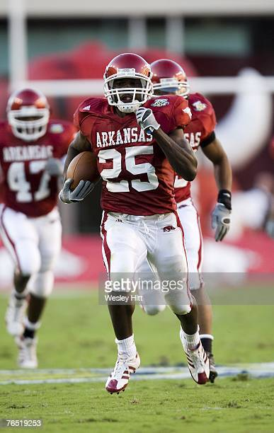 Felix Jones of the Arkansas Razorbacks returns a kickoff for a touchdown during a game against the Troy Trojans at Donald W Reynolds Stadium on...
