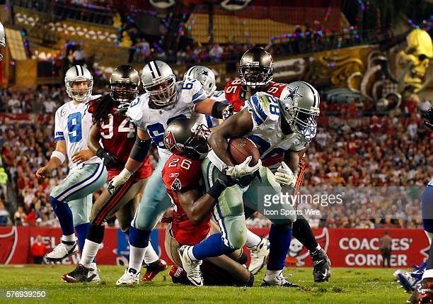 Felix Jones of the Cowboys is dragged down from behind by Sean Jones of the Buccaneers just short of the goal line during the regular season game...