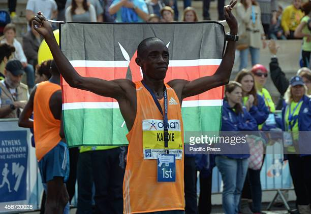 Felix Kandie poses for the press with a flag of his country Kenya The 32nd Athens Marathon the Authentic was organised in Athens with thousands of...