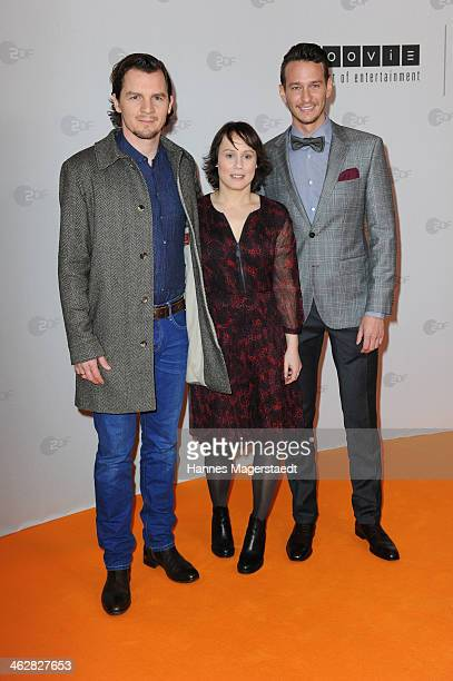 Felix Klare Eva Loebau and Vladimir Burlakov attends the premiere of the film 'Der Clan Die Geschichte der Familie Wagner' at Gloria Palast on...