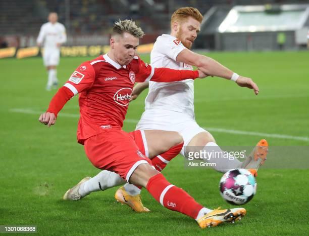 Felix Klaus of Duesseldorf is challenged by Mikkel Kirkeskov of Kiel during the Second Bundesliga match between Fortuna Düsseldorf and Holstein Kiel...