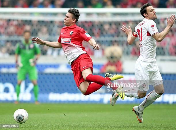 Felix Klaus of Freiburg is challenged by Christian Gentner of Stuttgart during the Bundesliga match between VfB Stuttgart and SC Freiburg at...