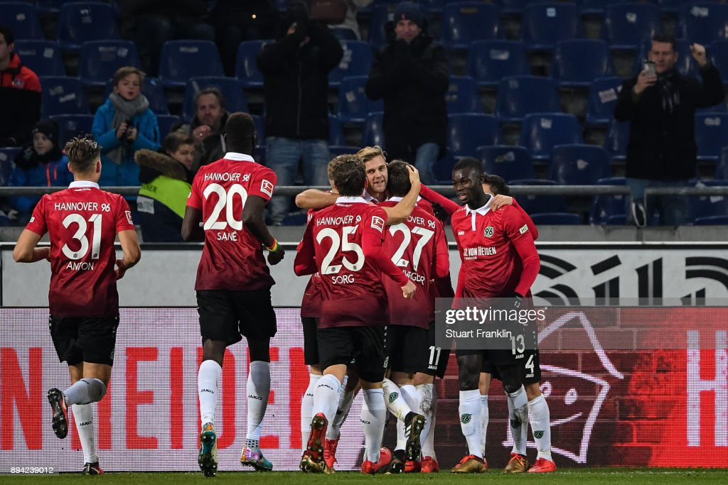 Felix Klaus #11 of Hannover 96 celebrates with his team-mates after scoring his team's third goal to make it 3-2 during the Bundesliga match between Hannover 96 and Bayer 04 Leverkusen at HDI-Arena on December 17, 2017 in Hanover, Germany.