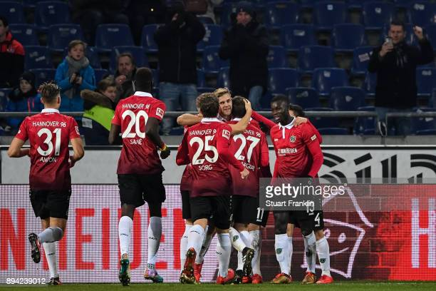 Felix Klaus of Hannover 96 celebrates with his teammates after scoring his team's third goal to make it 32 during the Bundesliga match between...