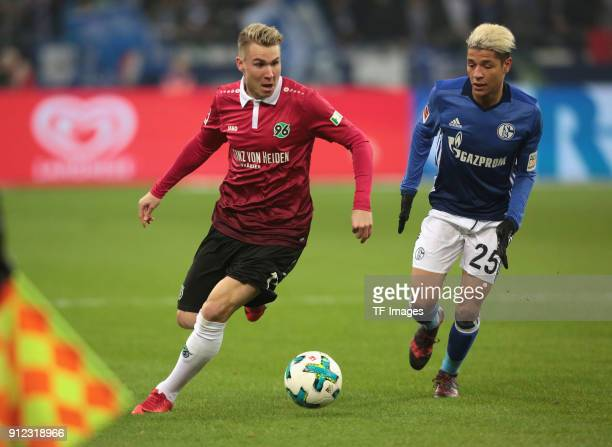 Felix Klaus of Hannover and Amine Harit of Schalke battle for the ball during the Bundesliga match between FC Schalke 04 and Hannover 96 at...