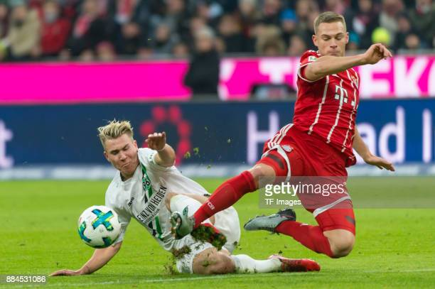 Felix Klaus of Hannover and Joshua Kimmich of Bayern Muenchen battle for the ball during the Bundesliga match between FC Bayern Muenchen and Hannover...