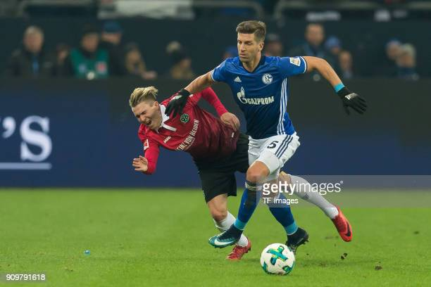 Felix Klaus of Hannover and Matija Nastasic of Schalke battle for the ball during the Bundesliga match between FC Schalke 04 and Hannover 96 at...