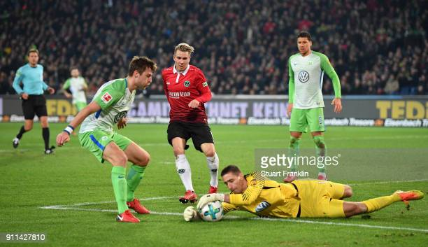 Felix Klaus of Hannover has a shot saved by Koen Casteels of Wolfsburg during the Bundesliga match between Hannover 96 and VfL Wolfsburg at HDIArena...