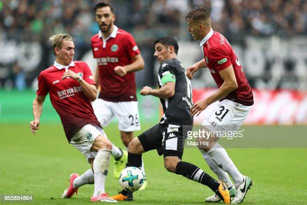 Felix Klaus of Hannover Lars Stindl of Moenchengladbach and Anton Waldemar of Hannover battle for the ball during the Bundesliga match between...