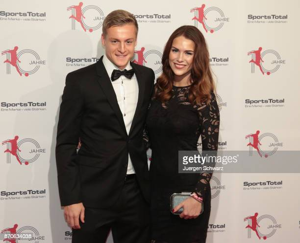 Felix Kroos and Lisa Klaas pose at the 10th anniversary celebration of the Sports Total Agency on November 5 2017 in Cologne Germany