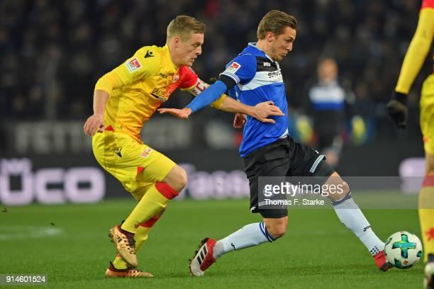 Felix Kroos of Berlin and Konstantin Kerschbaumer of Bielefeld fight for the ball during the Second Bundesliga match between DSC Arminia Bielefeld...