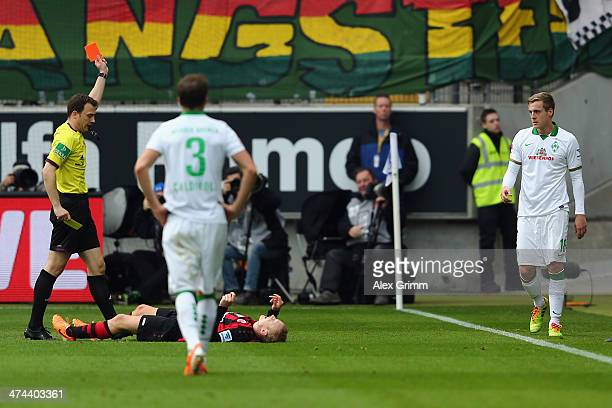 Felix Kroos of Bremen is sent off by referee Felix Zwayer during the Bundesliga match between Eintracht Frankfurt and Werder Bremen at Commerzbank...