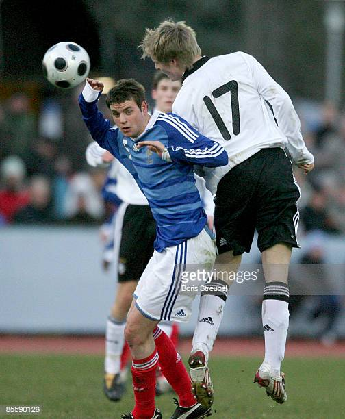 Felix Kroos of Germany and Sebastian Faure of France jumps for a header during the U18 International friendly match between Germany and France at the...