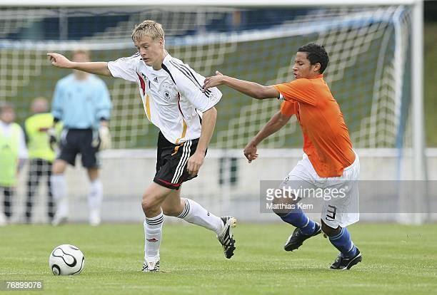 Felix Kroos of Germany battles for the ball with Ricardo van Rhijn of Netherlands during the U17 international friendly match between Germany and...