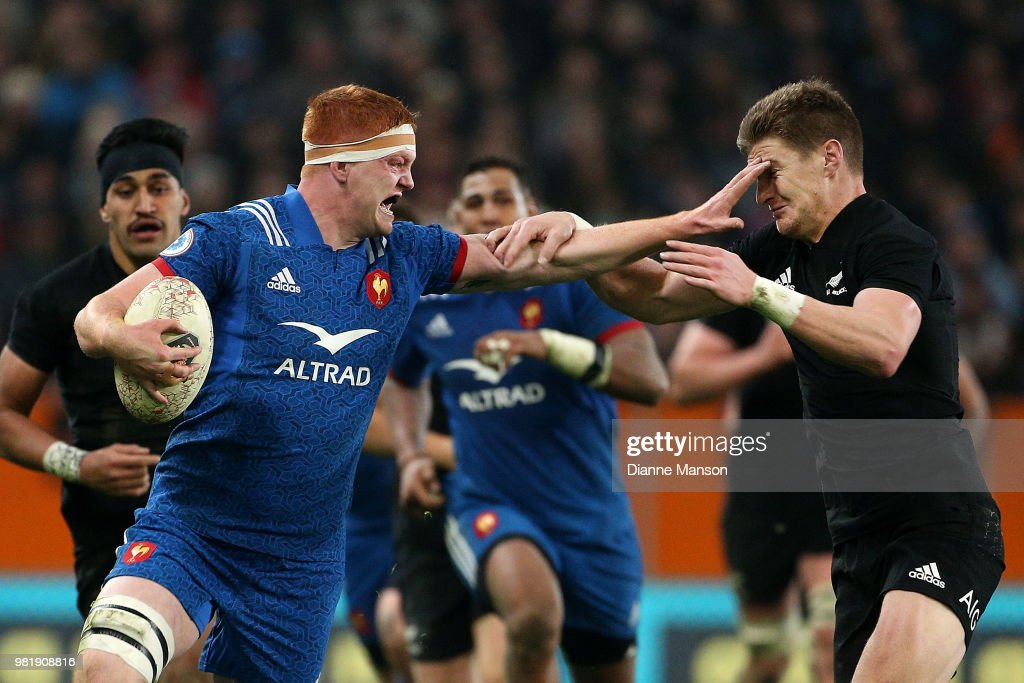 Felix Lambey of France fends off Jordie Barrett of the All Blacks during the International Test match between the New Zealand All Blacks and France at Forsyth Barr Stadium on June 23, 2018 in Dunedin, New Zealand.