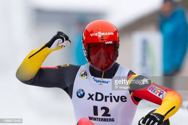 Felix Loch of Germany celebrates after the completes the sprint men's competition of the FIL World Cup at Veltins Eis-Arena on January 25, 2019 in...