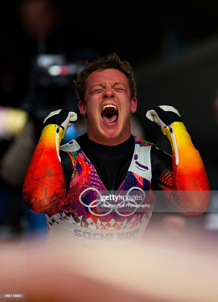 Felix Loch of Germany celebrates winning the gold medal with his girlfriend Lisa Ressle during the Men's Luge Singles on Day 2 of the Sochi 2014 Winter Olympics at Sliding Center Sanki on February 9, 2014 in Sochi, Russia.