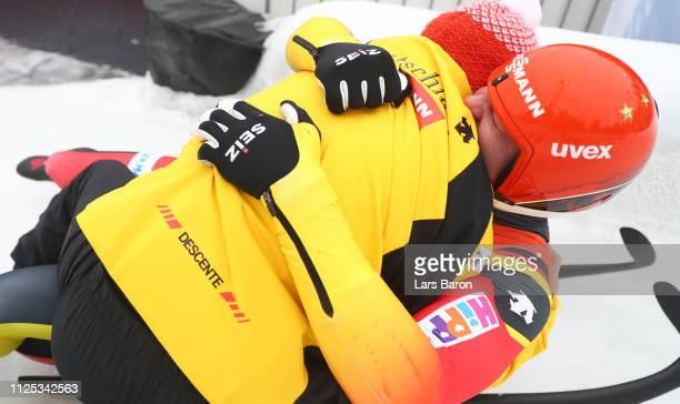 Felix Loch of Germany celebrates with his father Norbert Loch after winning the final run of the Luge Men's Single World Championship at Veltins...