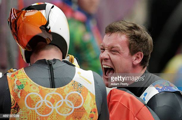 Felix Loch of Germany celebrates with Natalie Geisenberger of Germany after their run during the Luge Relay on Day 6 of the Sochi 2014 Winter...