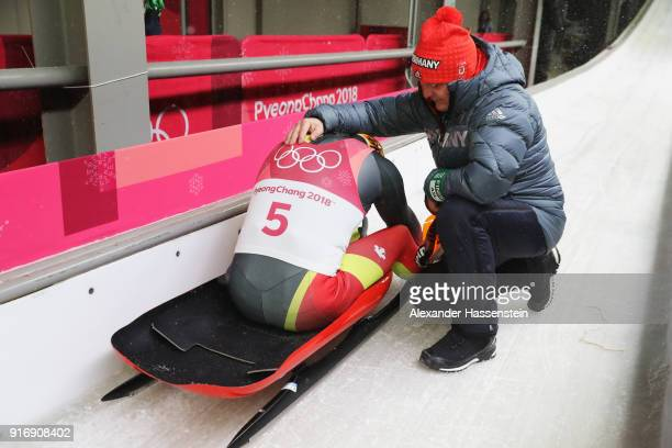 Felix Loch of Germany is consoled by his father Norbert Loch after finishing overall fifth following run 4 during the Luge Men's Singles on day two...