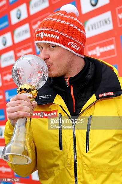 Felix Loch of Germany poses with the trophy after winning the World Cup of the Men's event of the Viessmann Luge World Cup Day 2 at Veltins EisArena...