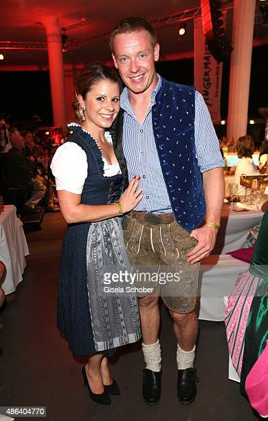 Felix Loch olympic champion bobsledding and his girlfriend Lisa Ressler during the Angermaier TrachtenNacht 2015 at Postpalast in Munich on September...