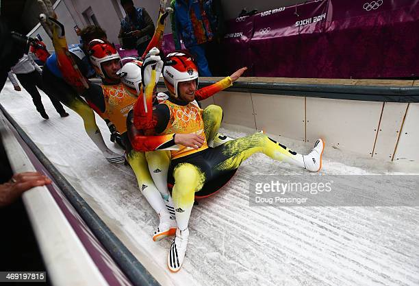 Felix Loch Tobias Wendl Natalie Geisenberger and Tobias Arlt of Germany celebrate winning the Luge Relay on Day 6 of the Sochi 2014 Winter Olympics...