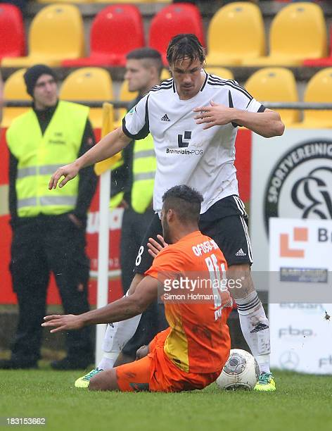 Felix Luz of Elversberg battles with Phil OfosuAyeh of Duisburg during the Third Bundesliga match between SV 07 Elversberg and MSV Duisburg at...