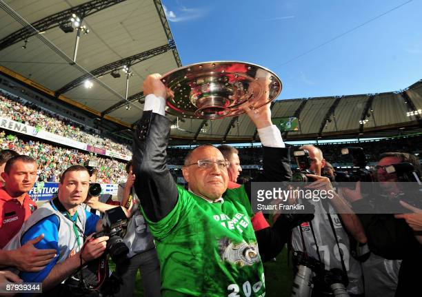 Felix Magath head coach of Wolfsburg celebrates lifting the German Championship trophy after the Bundesliga match between VfL Wolfsburg and Werder...