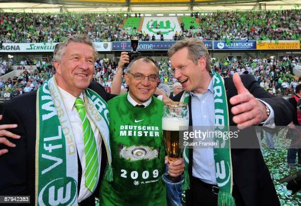 Felix Magath Head Coach of Wolfsburg celebrates with Buergermeister Rolf Schnellecke and Christian Wulff of CDU party winning the German championship...