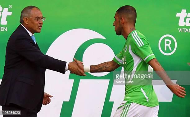Felix Magath head coach of Wolfsburg shake hands with Ashkan Dejagah of Wolfsburg during the Bundesliga match between VfL Wolfsburg and 1 FC...